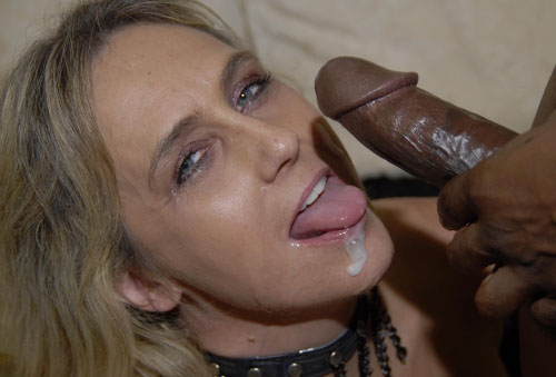 Look at this kneeling mature lady sucking those black dicks and getting her ...